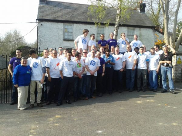 Group of happy volunteers outside China Works